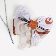 Loungefly x Star Wars Rey hair bow and Body Vibe Rey Lightsaber necklace ⭐️The Kessel Runway ⭐️ Star Wars fashion ⭐️ Geek Fashion ⭐️ Star Wars Style ⭐️ Geek Chic ⭐️