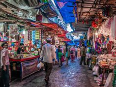 Whether you want fabrics from Ghana or soccer balls from Bolivia these colorful street markets offer handmade goods local finds and a whole lot of culture. Bollywood Posters, Vintage Bollywood, Shopping Street, Chor, Incredible India, Asia Travel, Marrakech, Middle East, Mumbai