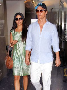 WEDDING HIGH    Basking in their newlywed bliss, Camila Alves and Matthew McConaughey make a hand-in-hand arrival at LAX on Sunday.