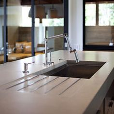 Articulated faucet, drainboard, seamless drain.    Modern kitchen by SB Architects.  From Houzz.
