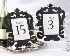 """""""Baroque"""" Openwork Table Number Card (Set of 1-15)  Quite simply the easiest way to an elegant tabletop! Kate Aspen's classic black, openwork baroque-inspired table number cards give clear direction to your guests while taking the """"wow"""" impact of your table decor to another level. A fabulous table finder!"""