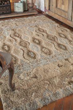 Semi twisted wool cut in a high shag in shades of khaki, beige, brown and sky blue.