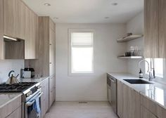 Stephanie Michaan Of The Interior Hamptons House White and Wood Kitchen