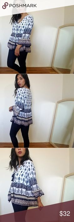 new| BOHO ME IVORY NAVY BELL SLEEVE TOP SUPER FAB ivory with navy paisley print top with 3/4 bell sleeves. Neckline is v shaped with a surplice style to it. Navy tassles with ivory ties. Small ruffle bell sleeves. Fits TTS.   ☞Sizes available: S M l ☞MODELING SIZE MEDIUM   I.G: JMAYORGA91  ❌PRICE FIRM❌ Tops