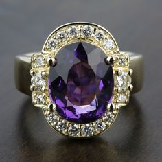 One of our more unique recently purchased rings! Would you wear this beautiful Amethyst Gemstone Statement Diamond Halo Ring in Yellow Gold?