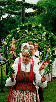 Dancing queens Women performing a dance in front of the maypole a celebration on the longest day which falls towards the end of June. by gusthed