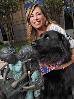 "Angela Atkins, victim of a dog bite at age 11, is the author of ""I Don't Like Dogs But They Love Me."" Her animal friend is Bingo, a therapy dog at Baptist Medical Center who is a character in the book."