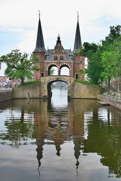 Waterpoort ~ Sneek, Friesland, The Netherlands:  A waterpoort is a water gate, a gate in a defensive wall that connects a city to a waterway.  Sneek is well known for its canals and Waterpoort, as well as water sports and cultural attractions.