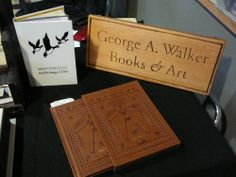Table featuring various wares from George A. Walker Books and Art, Toronto, Ont. Photo by Don McLeod.