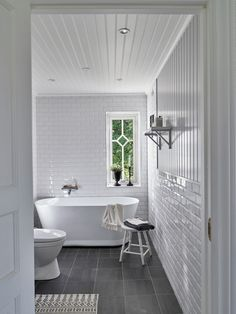 They turned the into a turn-of-the-century villa in Ljung Laundry Room Bathroom, Bathrooms, Subway Tiles, Clawfoot Bathtub, Villa, Interior, House, Home Decor, 1990s