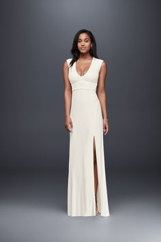 For your casual wedding, a crisp white jersey sheath wedding dress with skirt slit. Shop this look at davidsbridal.com