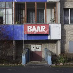 """""""After the fall of the Soviet Union, commercial shops in the basements of multi-story buildings started to appear in Estonia. In Tallinn, they were most likely to be found in the Lasnamäe district."""" - Commercial Lasnamäe by photographer Vladimir Ljadov"""