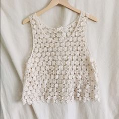 Floral crochet top Cream colored loose fitting crochet like top. Perfect for summer! Worn a couple times size small Tops Tank Tops