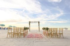 Blush and Gold Beachfront Wedding Ceremony at Clearwater Beach Wedding Venue Hilton Clearwater Beach | Flowers by Iza's Flowers, Gold Chiavari Chairs by Signature Event Rentals