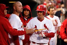 Allen Craig is congratulated by teammates after scoring on a wild pitch during the fourth inning of a baseball game against the Atlanta Braves. Cards won 5-2. 5-16-14