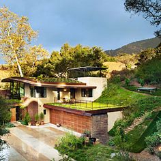 Tilted roof feeds onto garage roof garden then water drains into 10,000 gallon cistern