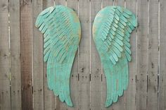Stunning set of large, hand painted metal angel wings. Done in very soft aqua and accented in gold with a protective coating. They each have 2 hangers on the back and can be hung in several different