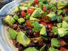 3 c. quinoa,1 can black beans, pt. cherry tomatoes, 1 c. cilantro, 2 avacados, lime juice.  Dressing:  1/4 c. Olive Oil, 1/4 c vinegar, 2-3 cloves minced garlic, salt & pepper to taste