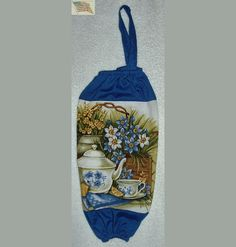 Hanging Bag Holder/Dispenser--Teapot, teacup,lemons and flowers--blue cotton fabric--terry cloth print--hanging loop--elastic top & bottom--all edges finished--holds 30-40 bags