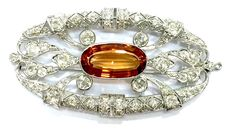 A very rare Imperial Topaz and diamonds art Deco' pendent/brooch