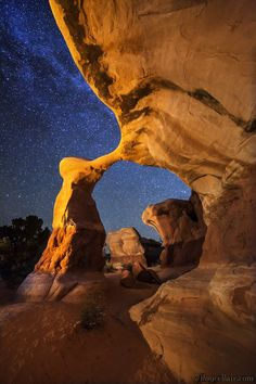 Starry Night at Metate Arch, Devil's Garden, Grand Staircase-Escalante National Monument - light painted (can you guess how many hidden lights are in this photo?). Compare the difference to the Blue Hour shot.  I recently spent a week scouting and photographing this area for our May 19-22, 2015 Escalante Workshop. Night Photo Blog |  Facebook | Google+ | Workshops