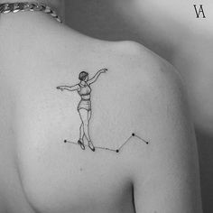 Fine line style constellation funambulist tattoo on the right shoulder blade.