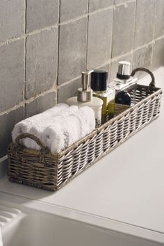 use a wicker bread server to house facecloths and lotions (bathrooms)