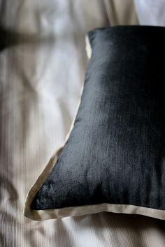 dark grey velvet cushion with taupe trim