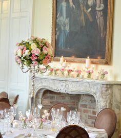 Cherie Kelly Fawsley Hall Wedding reception guests table candelabra flower arrangements tall and low centrepieces fireplace