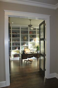white crown molding dark wood floors light blue wall white shelving home blue home office dark wood