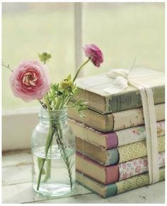 "ANY LITTLE STACK OF BOOKS SAYS MUCH--THE RIBBON AND FLOWER SAY ""WE ARE SPECIAL""--THE BOOKS THEMSELVES  BRING MANY EMOTIONS"