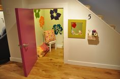 Playhouse under the stairs.  We could Sectioned off tall portion were normal door would go for a built in bookshelf.