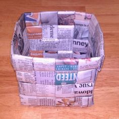 Make a basket from newspaper.  A version of the Girl Scout Sit Up ON  by suziscrafts.com/how-to-make-a-basket/