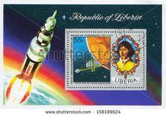 LIBERIA - CIRCA 1973: stamp printed by Liberia, shows Nicolaus Copernicus and concept of orbiting station around Mars, circa 1973 - stock photo