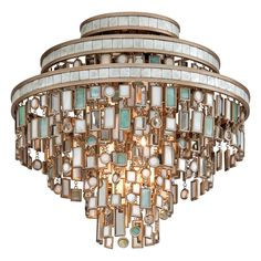 This fixture comes in a dolcetti silver finish and decorated with mixed shells with crystal and stainless accents.