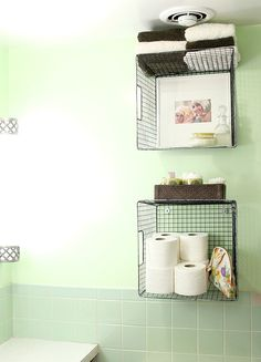 I already possess these white wire baskets, but they're sort of huge. I would want you to take a look at them, before I throw them away. 11 Fantastic Small Bathroom Organizing Ideas: hang wire baskets on the wall for bathroom storage via A Beautiful Mess Bathroom Towel Storage, Bathroom Storage Solutions, Small Bathroom Organization, Diy Organization, Organizing Ideas, Organized Bathroom, Bathroom Baskets, Hanging Wire Basket, Wire Baskets