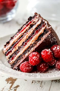a slice of moist Chocolate Raspberry Cake on its side showing layers of dark chocolate cake, raspberry jam filling, chocolate ganache and chocolate mousse Chocolate Filling For Cake, Chocolate Raspberry Cake, Dark Chocolate Cakes, Chocolate Recipes, Raspberry Filling For Cake, Chocolate Ganache Cake, Raspberry Ganache, Baking Recipes, Cake Recipes