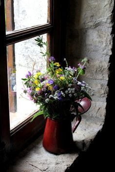 Family Uses 17th Century Tiny Stone Cottage in France for Escapades-never enough bouquets.