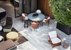 "Minotti Outdoor Collection | Van Dyck ""Outdoor"" table, Aston Cord ""Outdoor"" chairs, Rodolfo Dordoni design"