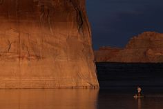 A paddleboarder floats by Lone rock on Lake Powell on March 29, 2015 near Big Water, Utah. Photo: Justin Sullivan