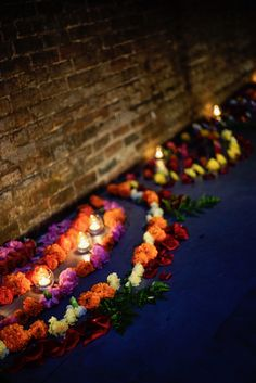 candles + flower mandalas lining the hallway as you enter the sacred space.