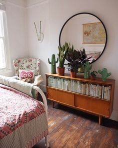 Mid century sideboard and round mirror in the bedroom