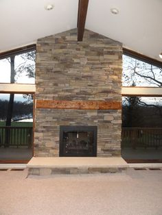 Bucks County Southern Ledgestone by Boral Cultured Stone with wood mantel and limestone hearth
