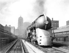 The 20th Century Limited leaving Chicago in 1938 with the Chicago Board of Trade Building in the background. - Art Deco aesthetics at its finest.