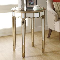 Mirrored accent table.