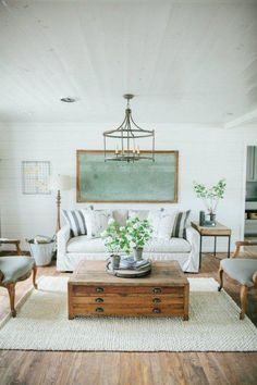 Beautiful family room - love the soft color brought into the space with artwork