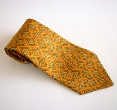 Vintage Joseph Abboud silk necktie in a rich tangerine background with a print in brown, black and gold. Marked Designed by Joseph Abboud and made in Italy.Measurements:The tie width is 10 cm (4 inches) at its largest point and 146 cm (57.5 inches) long.Condition: Excellent
