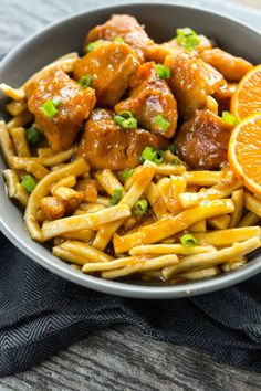 Slow Cooker Orange Chicken- vegan orange chicken and linguine (or some other noodle) with the sauce.