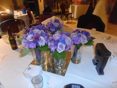 We used the bridemaids flower as the center piece for the bride and grooms family table.