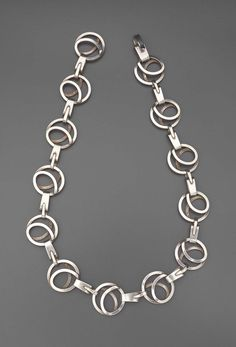 Linked loops of silver, matches pair of earrings DF.INV.459.1-2